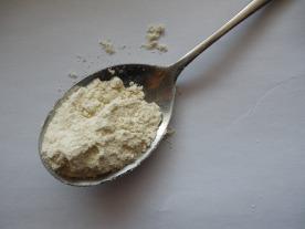 flour on spoon